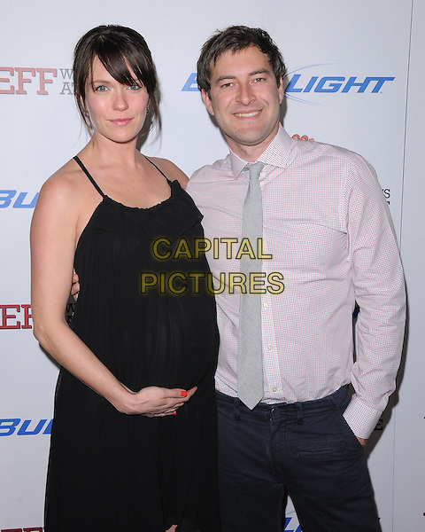 """Katie Aselton & Mark Duplass.""""Jeff, Who Lives At Home"""" Los Angeles Premiere held at the Directors Guild of America, West Hollywood, California, USA..March 7th, 2012.half length dress pink shirt couple pregnant black .CAP/RKE/DVS.©DVS/RockinExposures/Capital Pictures."""