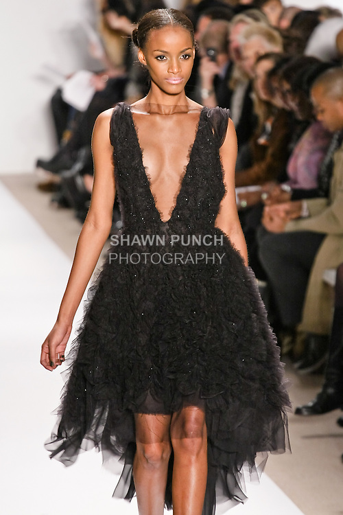 Sedene Blake walks the runway in a black silk tulle dress, by Dennis Basso for his Dennis Basso Fall Winter 2010 collection fashion show, during Mercedes-Benz Fashion Week Fall 2010.