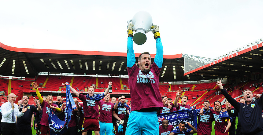 Burnley players celebrate becoming champions of the Sky Bet Championship, as Tom Heaton lifts an inflatable trophy<br /> <br /> Photographer Kevin Barnes/CameraSport<br /> <br /> Football - Sky Bet Football League Championship - Charlton Athletic v Burnley - Saturday 7th May 2016 - The Valley - London<br /> <br /> &copy; CameraSport - 43 Linden Ave. Countesthorpe. Leicester. England. LE8 5PG - Tel: +44 (0) 116 277 4147 - admin@camerasport.com - www.camerasport.com