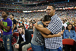 Maggie and Pete Carrasquillo, of Houston, worship during The Response: A Call to Prayer for a Nation in Crisis hosted by Texas' Governor Rick Perry, at Reliant Stadium in Houston, Texas on Saturday, August 6, 2011. An estimated 30,000 people, mostly Christian, attended the event that was largely seen as a politically controversial as Perry nears a decision on whether to seek Republican nomination for president...Ben Sklar for Newsweek Magazine