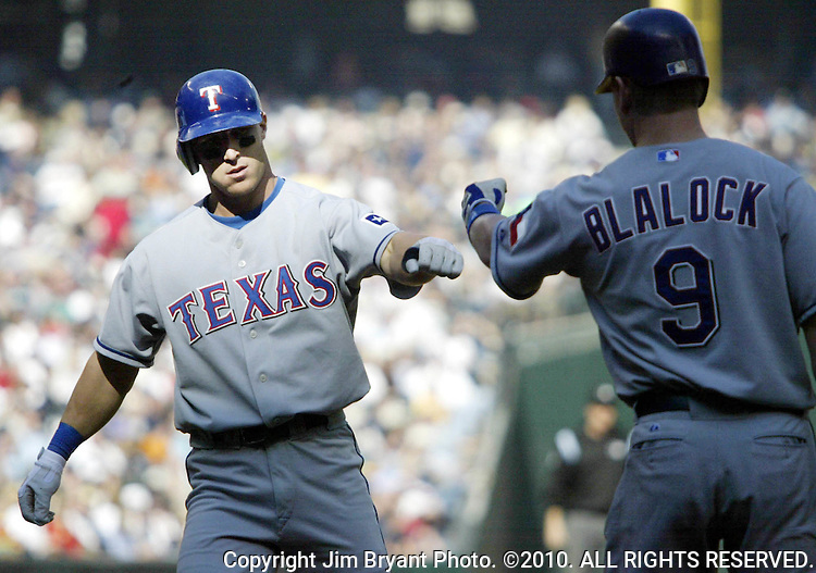 Texas Rangers Laynce Nix is greeted at honme plate after by Hank Blalock after he hit a home run to right field against the Seattle Mariners in the third inning at Safeco Field on Sunday, Oct. 3, 2004 in Seattle. Jim Bryant Photo. ©2010. ALL RIGHTS RESERVED.