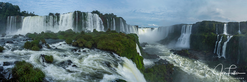 Iguazu Falls National Park in Argentina at right with Brazil at left.  A UNESCO World Heritage Site.  Pictured is the Santa Maria Waterfall at left with the Devil's Throat or Garganta del Diablo, center, and Salto Mitre and the Belgrano Waterfall at right.