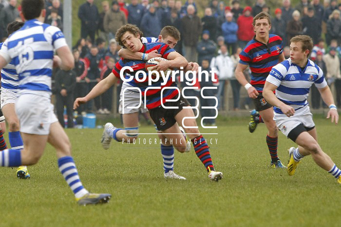 05/03/2013 Sonny Dwyer of Rockwell College gets to grips with Dan Goggin of St Munchins College in the Munster Schools Senior Cup Semi Final which took place at Clanwilliam Park, Tipperary Picture: Don Moloney / Press 22