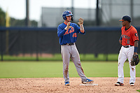GCL Mets Ryan Shinn (46) calls time during a Gulf Coast League game against the GCL Astros on August 10, 2019 at FITTEAM Ballpark of the Palm Beaches Training Complex in Palm Beach, Florida.  GCL Astros defeated the GCL Mets 8-6.  (Mike Janes/Four Seam Images)