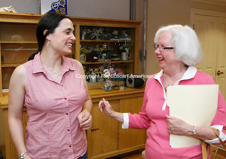 CHESHIRE, CT 07/28/09- 072809BZ05-  Laura DeCaprio, 3rd district representative, talks with Cheshire Democratic Town Committee member Theresa Grahame after being nominated for reelection during their caucus Tuesday night.<br /> Jamison C. Bazinet Republican-American