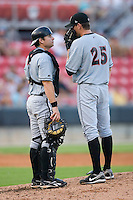 Catcher Adam Ricks #7 of the Birmingham Barons chats with his pitcher Kyle McCulloch #25 at Five County Stadium August 15, 2009 in Zebulon, North Carolina. (Photo by Brian Westerholt / Four Seam Images)