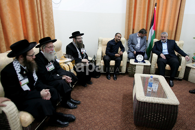 Palestinian Prime minister of Hamas Ismail Haniya meets U.S. members of Neturei Karta, a fringe ultra-Orthodox movement within the anti-Zionist bloc, during their visit to Gaza City July 16, 2009. About 200 international activists, among them the members of Neturei Karta, arrived in Gaza on Wednesday after passing though the Rafah border crossing from Egypt.    photo by Naaman Omar