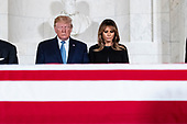 US President Donald J. Trump (L) and First Lady Melania Trump (R) pay their respects in front of the flag-draped casket of late US Supreme Court Justice John Paul Stevens as he lies in repose in the Great Hall of the Supreme Court, in Washington, DC, USA, 22 July 2019. Stevens, who served on the Supreme Court for nearly thirty-five years, died at age ninety-nine, 16 July.<br /> Credit: Michael Reynolds / Pool via CNP