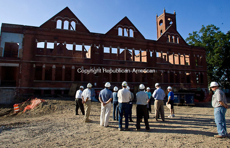 WATERBURY, CT - 02 SEPTEMBER 2009 -090209JT05-<br /> Board of Education members take a tour around Duggan School in Waterbury on Wednesday with architects and consultants as the 100-year-old school is under construction.<br /> Josalee Thrift Republican-American