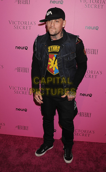 "BENJI MADDEN.The Victoria's Secret 6th Annual ""What Is Sexy? List: Bombshell Summer Edition"" Pink Carpet Event at The Beverly in Los Angeles, California, USA. .May 12th, 2011 .full length black jeans denim jacket sleeveless top baseball cap hat hand in pocket tattoos.CAP/ROT/TM.©Tony Michaels/Roth Stock/Capital Pictures"