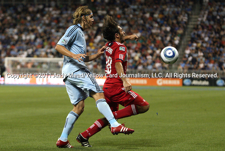 09 June 2011: Kansas City's Chance Myers (left) and Chicago's Gaston Puerari (URU) (18). Sporting Kansas City played the Chicago Fire to a 0-0 tie in the inaugural game at LIVESTRONG Sporting Park in Kansas City, Kansas in a 2011 regular season Major League Soccer game.