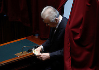 Il senatore a vita ed ex presidente del Consiglio Mario Monti vota durante la seduta comune di deputati e senatori per l'elezione del nuovo Presidente della Repubblica, alla Camera dei Deputati, Roma, 30 gennaio 2015.<br /> Italian senator for life and former premier Mario Monti votes during a joint plenary session of senators and deputies to vote for the election of the new President, at the Lower Chamber, Rome, 30 January 2015.<br /> UPDATE IMAGES PRESS/Riccardo De Luca