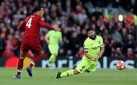 Barcelona's Luis Suarez goes down under the challenge from Liverpool's Virgil van Dijk<br /> <br /> Photographer Rich Linley/CameraSport<br /> <br /> UEFA Champions League Semi-Final 2nd Leg - Liverpool v Barcelona - Tuesday May 7th 2019 - Anfield - Liverpool<br />  <br /> World Copyright &copy; 2018 CameraSport. All rights reserved. 43 Linden Ave. Countesthorpe. Leicester. England. LE8 5PG - Tel: +44 (0) 116 277 4147 - admin@camerasport.com - www.camerasport.com