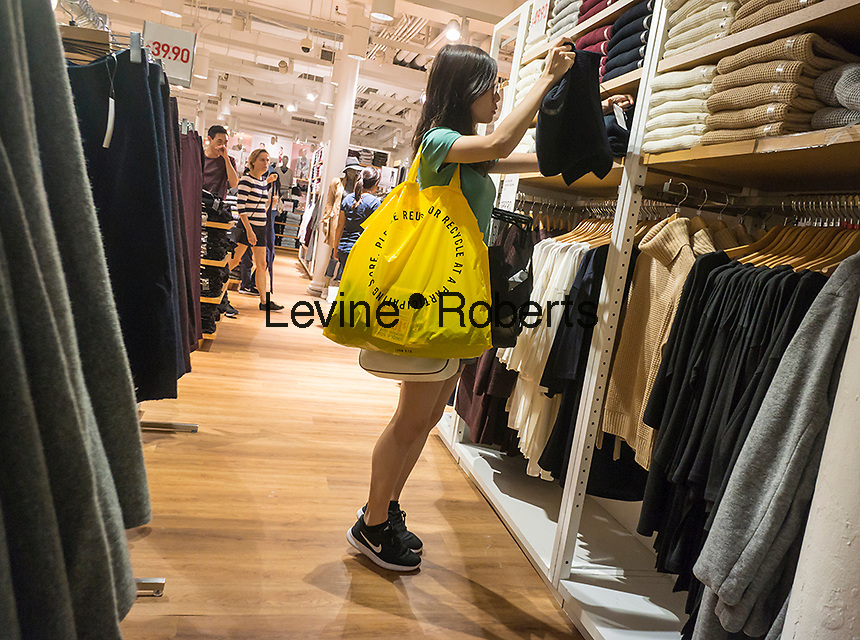 Shopping in the newly renovated Uniqlo store in Soho in New York on Saturday, September 3, 2016. (©Richard B. Levine)
