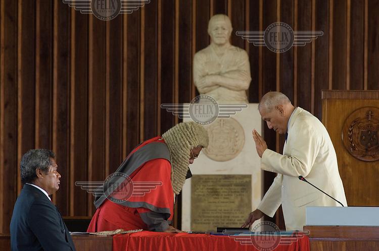 Tuiatua Tupua Tamasese Efi (right) is sworn in as Samoa's new Head of State in the parliament building.