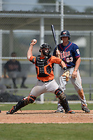 Catcher Alex Murphy (65) of the Baltimore Orioles organization throws down in front of Travis Harrison (63) during a minor league spring training game against the Minnesota Twins on March 20, 2014 at Buck O'Neil Complex in Sarasota, Florida.  (Mike Janes/Four Seam Images)
