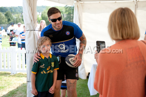 Matt Banahan of Bath Rugby poses for a photo with a young supporter. Bath Rugby Family Festival of Rugby, on August 8, 2015 at the Recreation Ground in Bath, England. Photo by: Patrick Khachfe / Onside Images