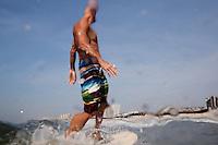 ROCKAWAY, NY - JUL 23: People surf at Rockaway Beach in Rockaway, NY. (Photo by Landon Nordeman)