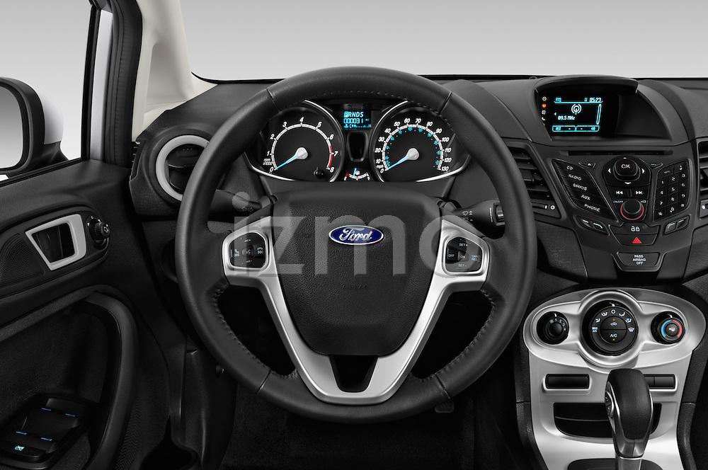 Car pictures of steering wheel view of a 2017 Ford Fiesta SE 5 Door Hatchback Steering Wheel