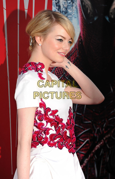 "Emma Stone.arriving at the Los Angeles premiere of ""The Amazing Spider-Man"" at Regency Village Theatre in Westwood, California, .USA, June 28th  2012. .half length side dress white red.CAP/ROT/TM.©TM/Roth Stock/Capital Pictures"