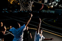 A group of young men play in a game of pick up basketball at the SF State outdoor basketball courts under a setting sun early Wednesday evening Sept. 26, 2007