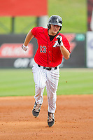 Zachary Fisher (13) of the Kannapolis Intimidators hustles towards third base with a triple against the Delmarva Shorebirds at CMC-Northeast Stadium on April 17, 2013 in Kannapolis, North Carolina.  The Shorebirds defeated the Intimidators 9-4.  (Brian Westerholt/Four Seam Images)