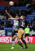 Bolton Wanderers' Josh Magennis competing with Sheffield Wednesday's Tom Lees <br /> <br /> Photographer Andrew Kearns/CameraSport<br /> <br /> The EFL Sky Bet Championship - Bolton Wanderers v Sheffield Wednesday - Tuesday 12th March 2019 - University of Bolton Stadium - Bolton<br /> <br /> World Copyright © 2019 CameraSport. All rights reserved. 43 Linden Ave. Countesthorpe. Leicester. England. LE8 5PG - Tel: +44 (0) 116 277 4147 - admin@camerasport.com - www.camerasport.com