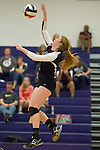 Round Rock's Paige Varga goes up to return the ball in play action against Cedar Ridge Tuesday.  (LOURDES M SHOAF for Round Rock Leader.)