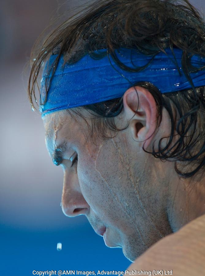 RAFAEL NADAL (ESP) against FELICIANO LOPEZ (ESP)  in the fourth round of the Men's Singles. Rafael Nadal beat Feliciano Lopez 6-4 6-4 6-2..22/01/2012, 22nd January 2012, 22.01.2012 - Day 7..The Australian Open, Melbourne Park, Melbourne,Victoria, Australia.@AMN IMAGES, Frey, Advantage Media Network, 30, Cleveland Street, London, W1T 4JD .Tel - +44 208 947 0100..email - mfrey@advantagemedianet.com..www.amnimages.photoshelter.com.