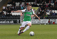 Lewis Stevenson being closed down by Steven Thomson in the St Mirren v Hibernian Clydesdale Bank Scottish Premier League match played at St Mirren Park, Paisley on 29.4.12. .