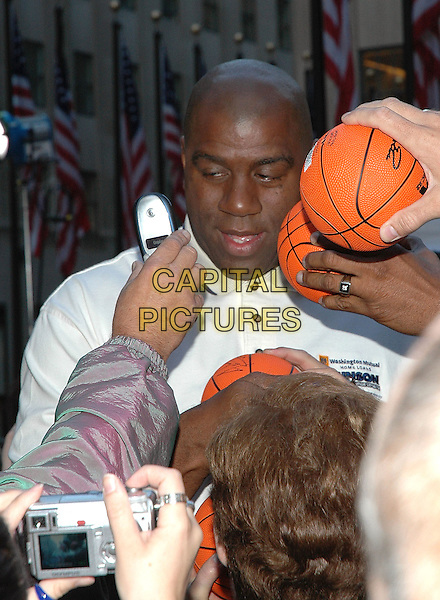 MAJIC JOHNSON.Signs autographs for fans after visiting the Habitat For Humanity Project on the NBC Today Show in Rockefeller Plaza, New York, New York..September 26th, 2005  .Photo Credit: Patti Ouderkirk/AdMedia/Capital Pictures.half length signing autographs basketball headshot portrait.www.capitalpictures.com.sales@capitalpictures.com.© Capital Pictures.