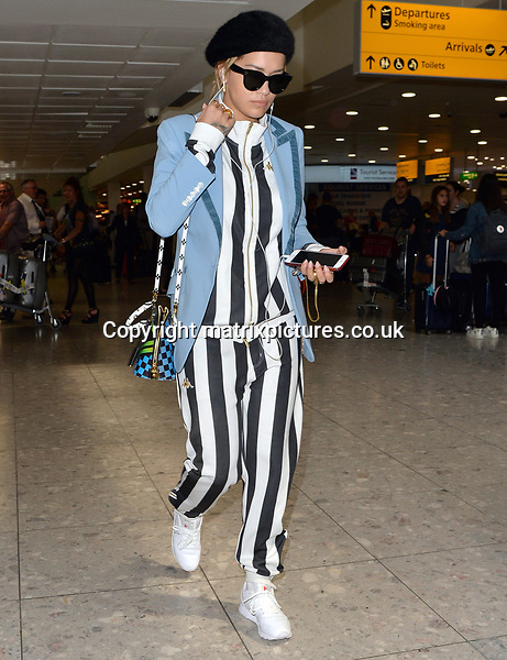 NON EXCLUSIVE PICTURE: MATRIXPICTURES.CO.UK<br /> PLEASE CREDIT ALL USES<br /> <br /> WORLD RIGHTS<br /> <br /> British singer and actress Rita Ora is pictured as she arrives at London's Heathrow airport.<br /> <br /> JUNE 14th 2017<br /> <br /> REF: LTN 171243