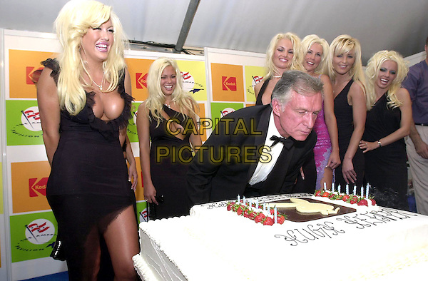 HUGH HEFNER.Founder of the Playboy empire, celebrates his 75th birthday with Playboy bunnies / Playmates at the American Pavillion,.Cannes Film Festival, France, 12th May 2001..half length blondes blowing out candles on cake.Ref: PL.www.capitalpictures.com.sales@capitalpictures.com.©Capital Pictures.