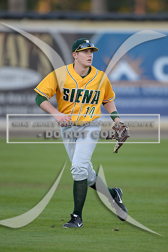Siena Saints outfielder Taylor Ahearn (14) during warmups before the season opening game against the Central Florida Knights at Jay Bergman Field on February 14, 2014 in Orlando, Florida.  UCF defeated Siena 8-1.  (Copyright Mike Janes Photography)