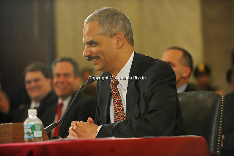 Eric Holder, Barack Obama's nominee for Attorney General, is questioned about his role in the pardon of investor Marc Rich when he served in President Bill Clinton's administration, his views on the Patriot Act, and his basketball game versus that of the President Elect Barack Obama during his confirmation hearing after being named for the post of Attorney General by Barack Obama at the Russell Senate building on Capitol Hill in Washington, DC on January 15, 2009.
