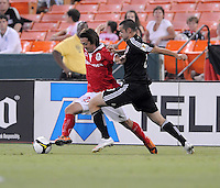 Toluca FC midfielder Diego De La Torres (21) shields the ball against DC United midfielder Andrew Jacobson (8).  Toluca FC defeated DC United 3-1in the Concacaf Champions League tournament,at RFK Stadium Wednesday, August 26  2009.