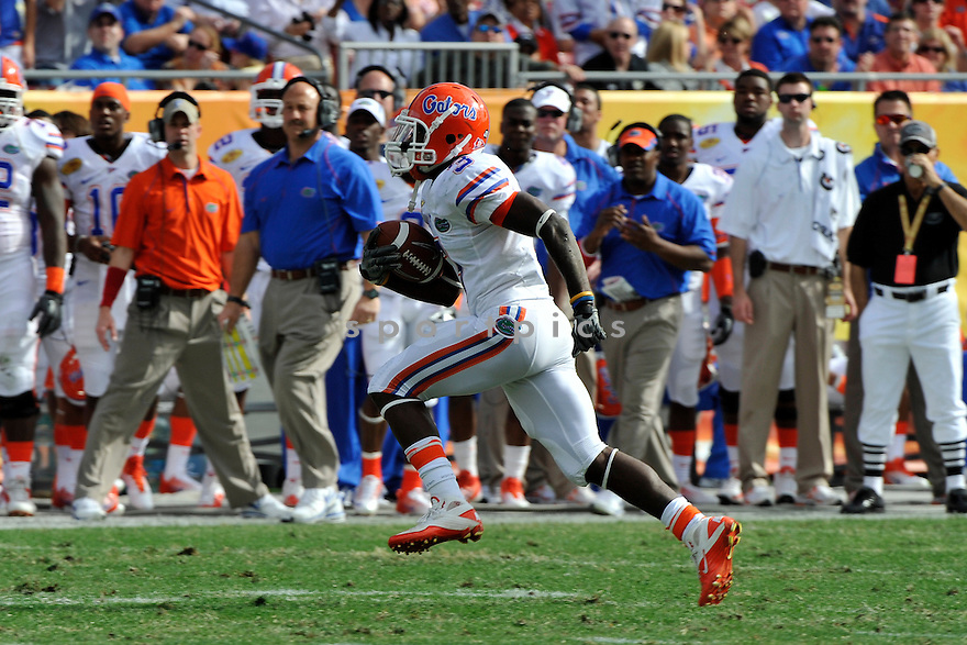 Jan 1 2011; Florida WR Chris Rainey (3) during  game against Penn State. Florida won the 25th anniversary of the Outback Bowl 37-24 at  Raymond James Stadium Tampa, FL. Mandatory Credit: Tomasso DeRosa