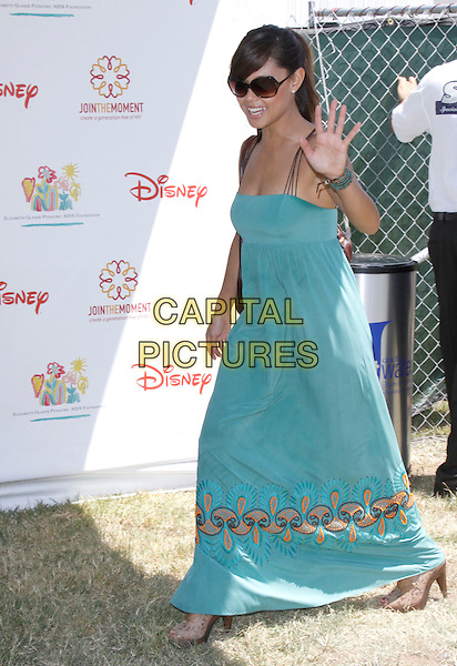 "VANESSA MINNILLO .The 20th annual ""A Time for Heroes"" Celebrity Carnival benefiting Elizabeth Glaser Pediatric AIDS Foundation held at Wadsworth Theater on the Veteran Administration Lawn in West Los Angeles, California, USA. .June 7th, 2009.full length blue dress teal long maxi  sunglasses shades hand palm waving .CAP/DVS                                                  .©Debbie VanStory/Capital Pictures."