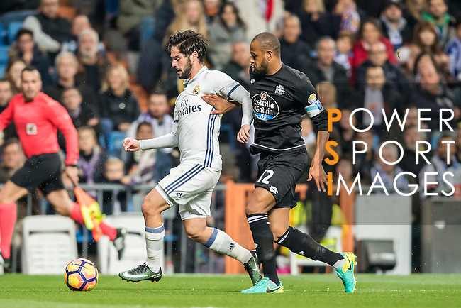 Isco (l) of Real Madrid competes for the ball with Sidnei Rechel da Silva Junior of RC Deportivo La Coruna during the La Liga match between Real Madrid and RC Deportivo La Coruna at the Santiago Bernabeu Stadium on 10 December 2016 in Madrid, Spain. Photo by Diego Gonzalez Souto / Power Sport Images