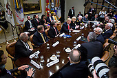 U.S. President Donald Trump, center left, speaks as he meets with county sheriffs during a listening session in the Roosevelt Room of the White House in Washington, D.C., U.S., on Tuesday, Feb. 7, 2017. The Trump administration will return to court Tuesday to argue it has broad authority over national security and to demand reinstatement of a travel ban on seven Muslim-majority countries that stranded refugees, triggered protests and handed the young government its first crucial test. <br /> Credit: Andrew Harrer / Pool via CNP