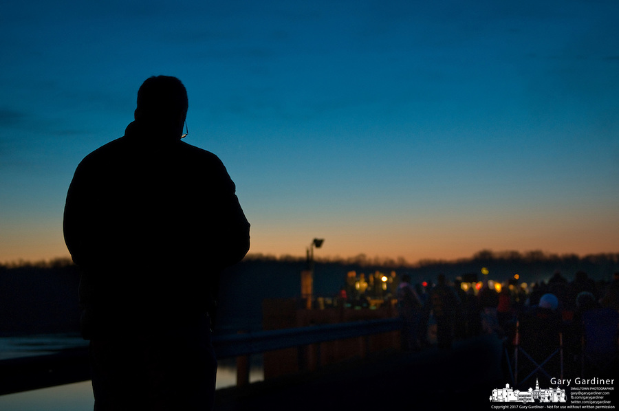 Worshippers gather for Easter sunrise services atop a dam at a reservoir.