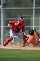 Boston Red Sox Alixon Suarez (25) tags Hector Veloz (17) sliding home during a minor league spring training game against the Baltimore Orioles on March 20, 2015 at Buck O'Neil Complex in Sarasota, Florida.  (Mike Janes/Four Seam Images)
