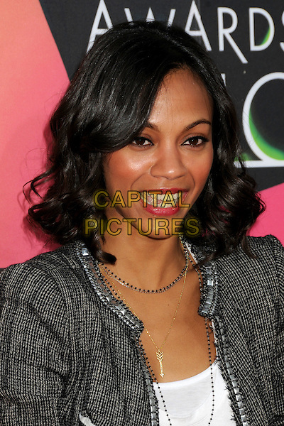ZOE SALDANA .at the 23rd Annual Nickelodeon Kids' Choice Awards 2010 held at Pauley Pavilion in Westwood, California, USA, March 27th 2010 .arrivals kids portrait headshot bob tweed jacket grey gray blazer white top t-shirt necklaces silver gold arrow charm black and white gingham houndstooth ribbon edged edge Mouth open .CAP/ADM/BP.©Byron Purvis/Admedia/Capital Pictures