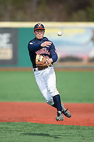 Justin Novak (18) of the Virginia Cavaliers makes a throw to first base during infield practice prior to the game against the Hartford Hawks at The Ripken Experience on February 27, 2015 in Myrtle Beach, South Carolina.  The Cavaliers defeated the Hawks 5-1.  (Brian Westerholt/Four Seam Images)
