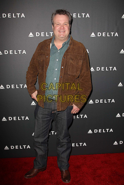 Eric Stonestreet.Delta Air Lines, the Official Airline of the GRAMMY Awards,celebrate LA's music industry Held At The Getty House, Los Angeles, California, USA, .7th February 2013..full length brown suede jacket grey gray trousers green shirt .CAP/ADM/KB.©Kevan Brooks/AdMedia/Capital Pictures.