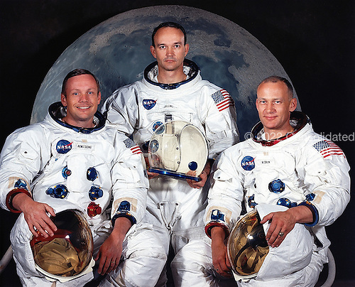 "Houston, TX - (FILE) -- Portrait of the prime crew of the Apollo 11 lunar landing mission taken on May 1, 1969. From left to right they are: Commander, Neil A. Armstrong, Command Module Pilot, Michael Collins, and Lunar Module Pilot, Edwin E. Aldrin Jr. On July 20th 1969 at 4:18 PM, EDT the Lunar Module ""Eagle"" landed in a region of the Moon called the Mare Tranquillitatis, also known as the Sea of Tranquillity. After securing his spacecraft, Armstrong radioed back to earth: ""Houston, Tranquility Base here, the Eagle has landed"". At 10:56 p.m. that same evening and witnessed by a worldwide television audience, Neil Armstrong stepped off the ""Eagle's landing pad onto the lunar surface and said: ""That's one small step for a man, one giant leap for mankind."" He became the first human to set foot upon the Moon..Credit: NASA via CNP"