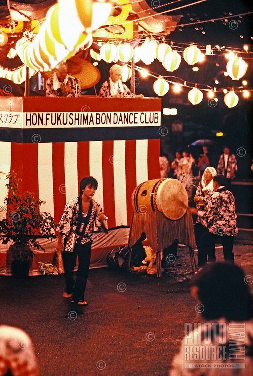 Participants of a traditional Japanese bon dance celebrate in Nuuanu with lanterns and drum.
