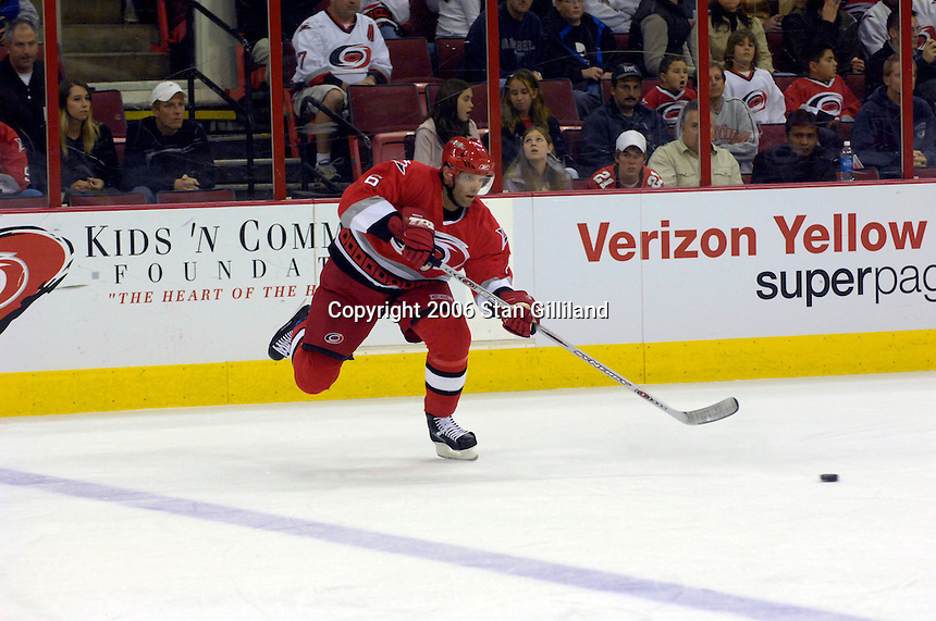 Carolina Hurricanes' Bret Hedican passes along the blue line during an NHL hockey game against the Boston Bruins Saturday, Dec. 2, 2006 in Raleigh, N.C. Carolina won 5-2.<br />