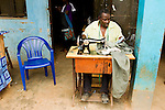Tailor sewing pants, Bigodi, western Uganda