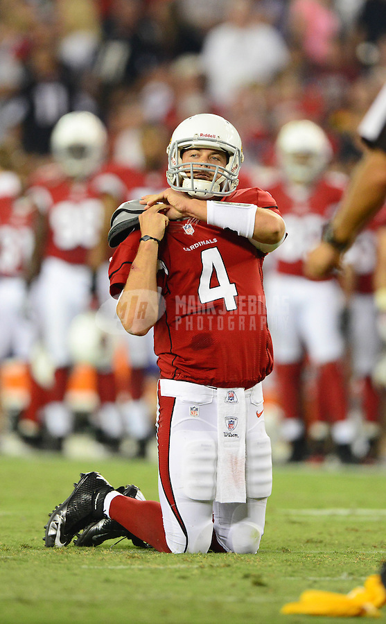 Aug. 17, 2012; Glendale, AZ, USA; Arizona Cardinals quarterback (4) Kevin Kolb adjusts his pads after being sacked by the Oakland Raiders in the second quarter during a preseason game at University of Phoenix Stadium. Mandatory Credit: Mark J. Rebilas-